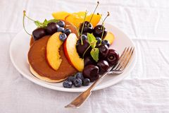 Pancakes with stone fruits Stock Photography