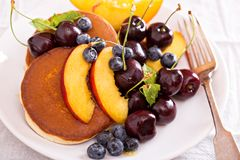 Pancakes with stone fruits Royalty Free Stock Images