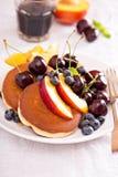 Pancakes with stone fruits Stock Photos