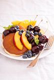 Pancakes with stone fruits Royalty Free Stock Photography