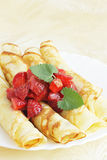 Pancakes with strawberries. Dessert with the strawberries/the roll pancakes Stock Image