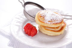 Pancakes with strawberries. Stock Images