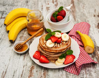 Pancakes with strawberries and bananas Stock Photo