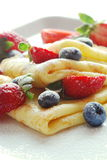 Pancakes with strawberries and blackbarries royalty free stock images