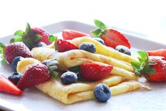 Pancakes  with strawberries and blackbarries Royalty Free Stock Photography