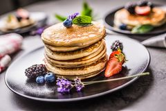 Pancakes with strawberries blackberries blueberries and lavender Royalty Free Stock Images