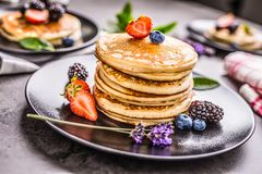 Pancakes with strawberries blackberries blueberries and lavender Royalty Free Stock Photos