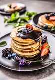 Pancakes with strawberries blackberries blueberries and lavender Royalty Free Stock Image