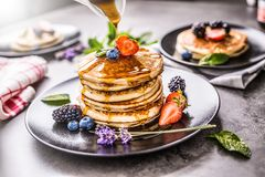 Pancakes with strawberries blackberries blueberries and lavender Stock Photography
