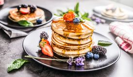 Pancakes with strawberries blackberries blueberries and lavender Stock Photos