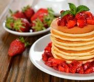 Pancakes with strawberries Stock Photos