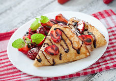 Pancakes with strawberries and chocolate Royalty Free Stock Photos
