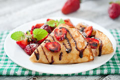 Pancakes with strawberries and chocolate Royalty Free Stock Photography