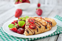 Pancakes with strawberries and chocolate Royalty Free Stock Images