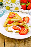 Pancakes with strawberries and cream on the board Stock Photos