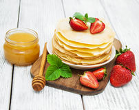 Pancakes with strawberries Stock Images
