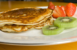 Pancakes with Strawberries and Kiwi Stock Photos