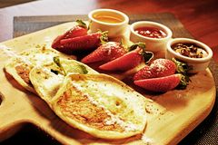 Pancakes, strawberries and sauce royalty free stock image