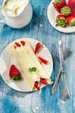 Pancakes with strawberries served with whipped cream Royalty Free Stock Photo