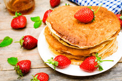 Pancakes with strawberries Stock Photos