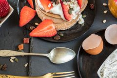 Pancakes with strawberries and yogurt. Healthy breakfast food set. stock photography