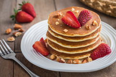 Pancakes with strawberry and almonds on plate Stock Photos