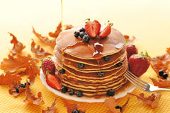 Pancakes with strawberry and blueberries royalty free stock photography