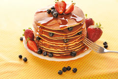 Pancakes with strawberry and blueberries Stock Photography