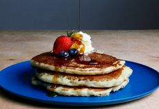 Pancakes With Strawberry, Blueberries, and Maple Syrup royalty free stock photo