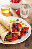 Pancakes with strawberry blueberry for breakfast Stock Images