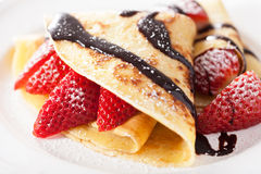 Pancakes with strawberry and chocolate sauce Royalty Free Stock Photography