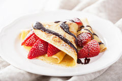 Pancakes with strawberry and chocolate sauce Royalty Free Stock Image