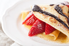 Pancakes with strawberry and chocolate sauce Stock Photography