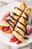 Pancakes with strawberry and chocolate sauce Stock Photos