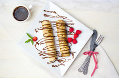 Pancakes with strawberry and chocolate royalty free stock image
