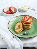 Pancakes with strawberry and cream Royalty Free Stock Images