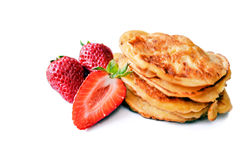 Pancakes with strawberry. Pancakes with fresh strawberry isolated on white Royalty Free Stock Photo