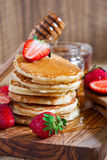 Pancakes with strawberry and honey. Homemade pancakes with ripe strawberry and honey. Selective focus Stock Photos
