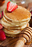 Pancakes with strawberry and honey. Homemade pancakes with ripe strawberry and honey. Selective focus. Close-up Royalty Free Stock Image