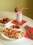 Pancakes with strawberry jam Stock Photos