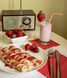 Pancakes with strawberry jam Stock Image