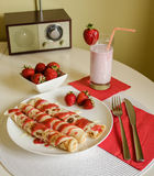 Pancakes with strawberry jam Stock Images