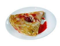 Pancakes with strawberry jam. Royalty Free Stock Images