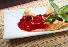Pancakes with strawberry jam Stock Photos