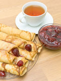 Pancakes with strawberry jam and a cup of tea. top view Royalty Free Stock Photos