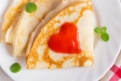 Pancakes with strawberry jam heart Royalty Free Stock Image