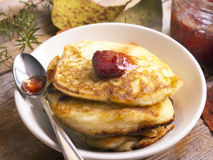 Pancakes and strawberry jam. Rural breakfast with pancakes and strawberry jam royalty free stock photography