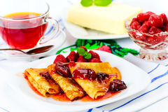 Pancakes with strawberry jam. Royalty Free Stock Photo