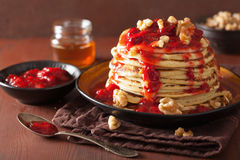 Pancakes with strawberry jam and walnuts. tasty dessert Royalty Free Stock Photos