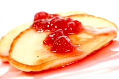 Pancakes with strawberry jam Royalty Free Stock Images